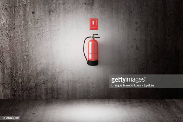 fire extinguisher on wall - fire extinguisher stock photos and pictures