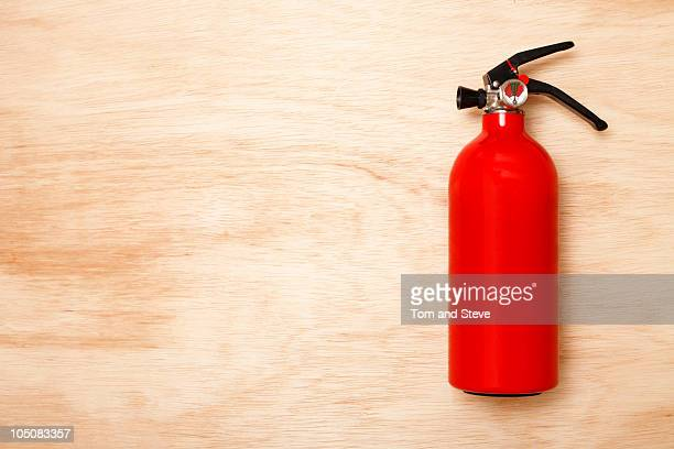 Fire Extinguisher On Wood Background