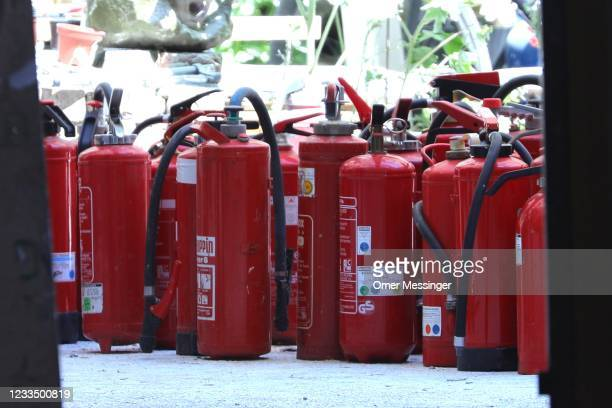 Fire extinguishers found at the Rigaer Strasse 94 leftist squat stand in the buildings yard on the day a fire inspector is to carry out an inspection...