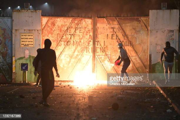 Fire fed by petrol burns as youths clashed at the Peace Gate at the Springfield Road/Lanark Way interface on April 7, 2021 in Belfast, Northern...
