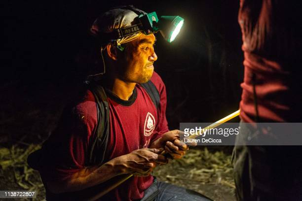 A fire fighter from Doi Mae Salong Station prepares his equipment before putting out a forest fire on the Thailand/Myanmar border on April 19 2019 in...