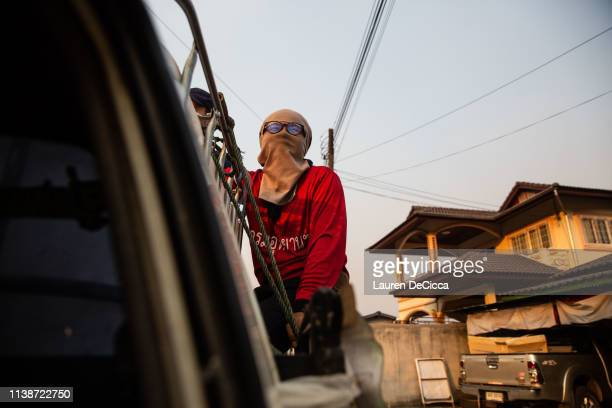 A fire fighter from Doi Mae Salong Station rides to the scene of a forest fire during his evening shift on April 19 2019 in Chiang Rai Thailand...