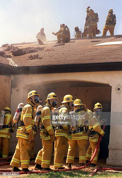 Fire fighter trainees take part in structure fire training burn involving a 10000 square foot home on Gabbert Rd in Moorpark A total of 20 trainees...