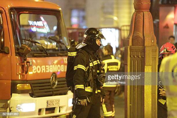 A fire fighter wearing a breathing apparatus is pictured in front of a fire truck The Puerta del Sol Metro station in central Madrid has been closed...