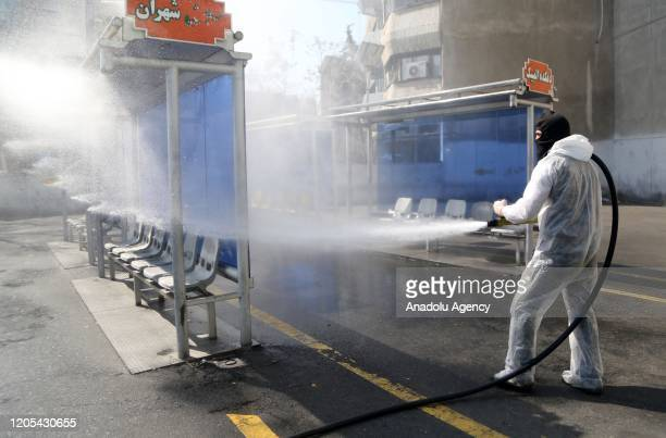 Fire fighters and municipality workers with protective suits disinfect the streets, buses and taxies as a precaution to the coronavirus in Tehran,...