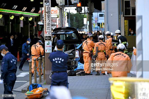 Fire fighters and paramedics continue rescue operation after a car crashed into pedestrians at Umeda area on February 25 2016 in Osaka Japan Two...