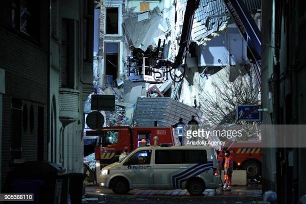 Fire fighters and police officers arrive at the scene after an explosion that caused a residential building to collapse in Antwerp district of...