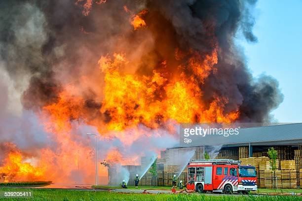 Fire fighters at an industrial inferno