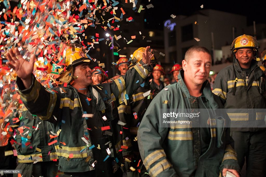 Fire fighters attend 2015 Cape Town Carnival at the Green Point Fan Walk in Cape Town on March 14, 2015. The theme for Cape Town Carnival 2015 is elemental. It celebrates fire, water, air and earth.