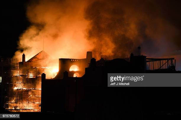 Fire fighters battle a blaze at the Mackintosh Building at the Glasgow School of Art for the second time in four years on June 16 2018 in Glasgow...