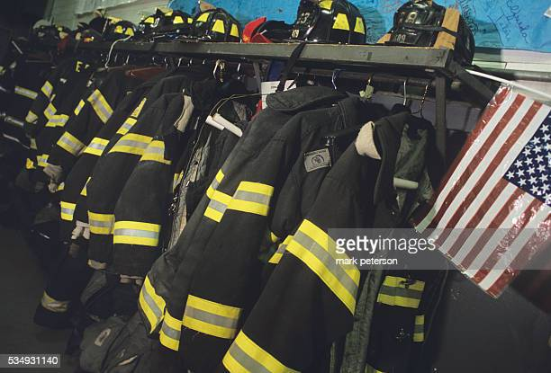 Fire fighters coats hang in Engine Company 23 This company lost 8 men in the World Trade Center attack in New York City