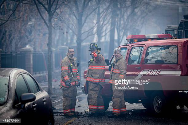 Fire fighters cool off with fire hydrants at the Avalon apartment complex in the Edgewater along the edge of the Hudson River, New Jersey state on...