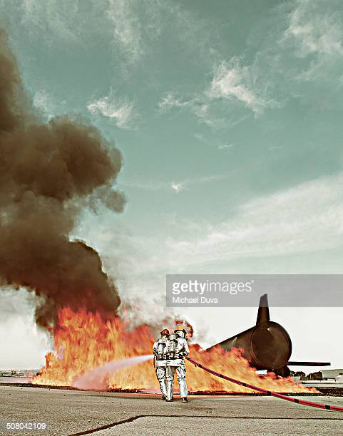 Fire fighters during simulation training of plane
