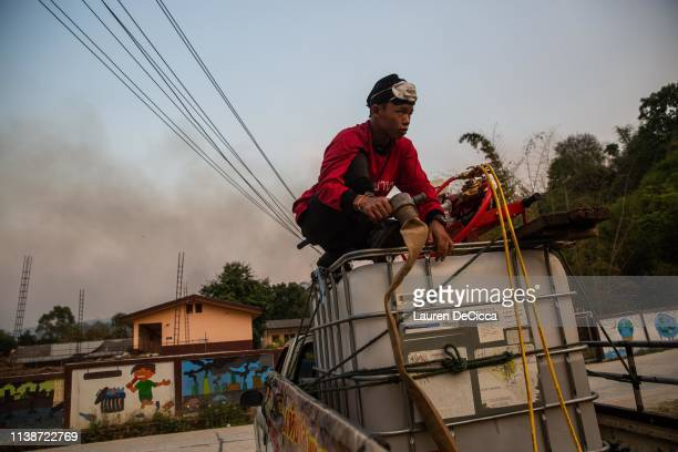 Fire Fighters from Doi Mae Salong Station fill their mobile water tank before heading to the scene of a forest fire on April 19 2019 in Chiang Rai...
