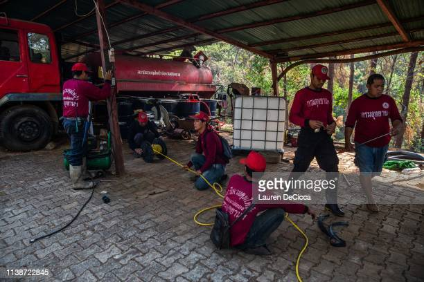 Fire Fighters from Doi Mae Salong Station pack their equipment before work on April 20 2019 in Chiang Rai Thailand Thailand's Northern Provinces of...