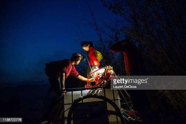 Fire Fighters from Doi Mae Salong Station prepare their equipment before putting out a forest fire on the Thailand/Myanmar border on April 19 2019 in...