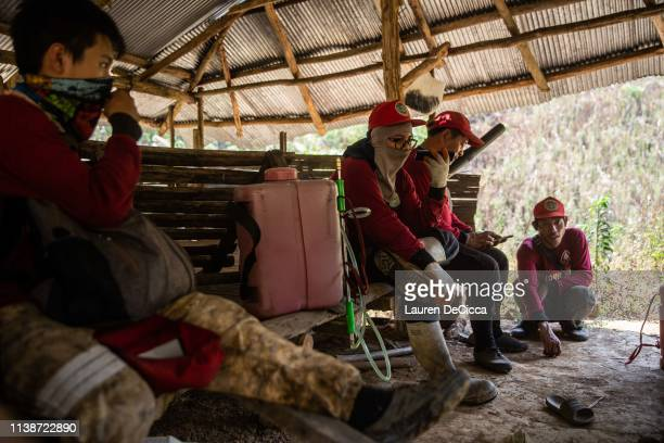 Fire Fighters from Doi Mae Salong Station take a rest after putting out a forest fire on April 20 2019 in Chiang Rai Thailand Thailand's Northern...