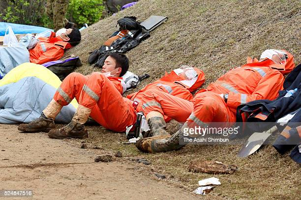Fire fighters in rescue operation take nap on April 23, 2016 in Minamiaso, Kumamoto, Japan. Southern Island of Kyushu has been devastated by two...