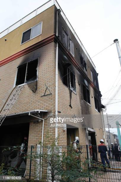 Fire fighters inspect an animation company which caught fire in Kyoto on July 18 2019 A fire at an animation company in Japan's Kyoto on July 18...