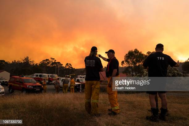 Fire fighters medics and police plan fire control strategies for the evening ahead on January 21 2019 in Miena Australia The Tasmania Fire Service...