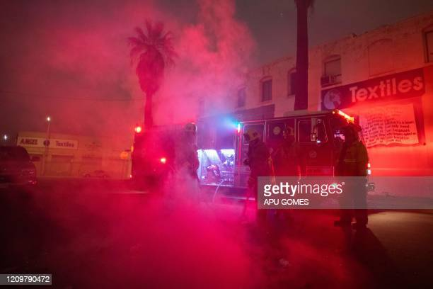 Fire Fighters of the LAFD Station No9 extinguish a fire on trash on April 12 2020 at Skid Row in Los Angeles California One of the busiest fire...
