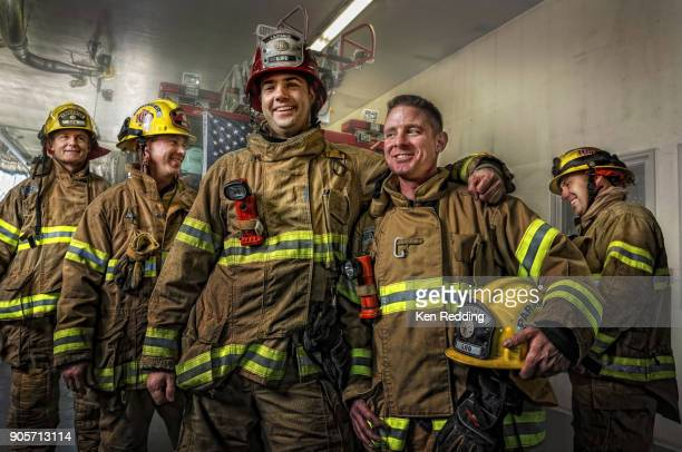 fire fighters - firefighter stock pictures, royalty-free photos & images