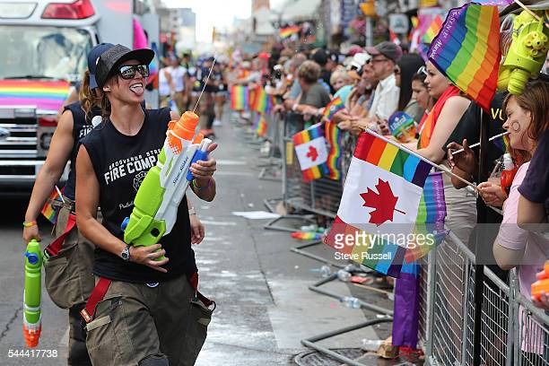 TORONTO ON JULY 3 Fire Fighters spray the crowd during the the 2016 Toronto Pride parade along Yonge Street in Toronto July 3 2016