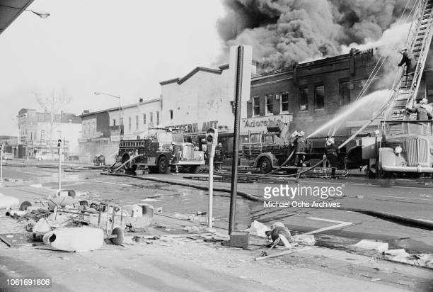 Fire fighters tackle a blaze on NE H Street during the riots in Washington DC following the assassination of civil rights activist Martin Luther King...