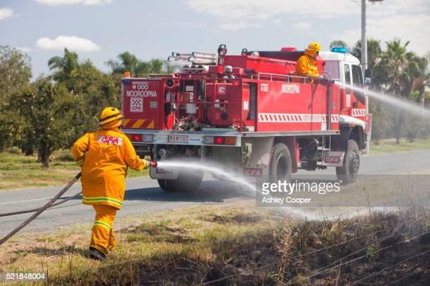 Fire fighters tackle a roadside fire near Shepperton