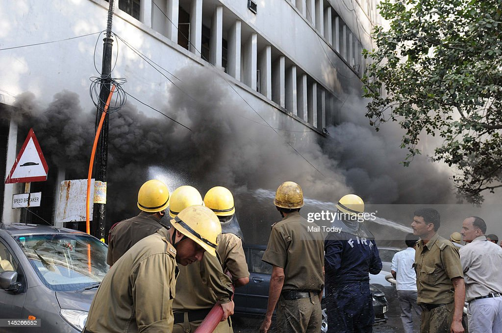 Fire fighters try to douse a major fire that broke out in a building housing Punjab National Bank at Parliament Street in New Delhi on Wednesday