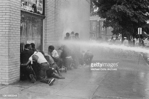 Fire fighters use fire hoses to subdue the protestors during the Birmingham Campaign in Birmingham Alabama May 1963 The movement which called for the...