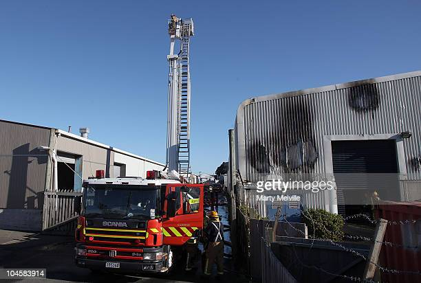 Fire fighters work on a warehouse after a fire broke out at director Peter Jackson's Portsmouth Miniatures Studio on October 1 2010 in Wellington New...