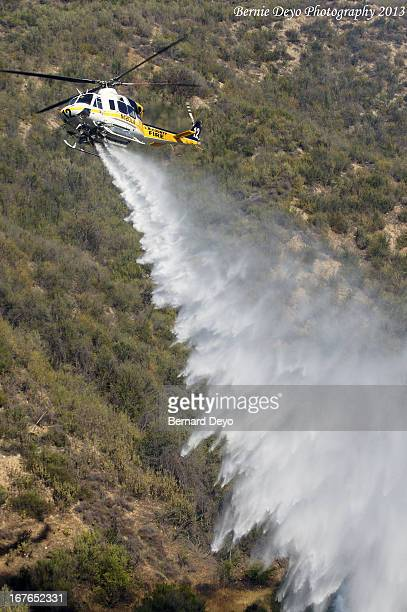 Fire Fighting Helicopters from the LACOFD, LAFD and VCSD help douse a small 5 acre Brush Fire in LACOFD 124s area.