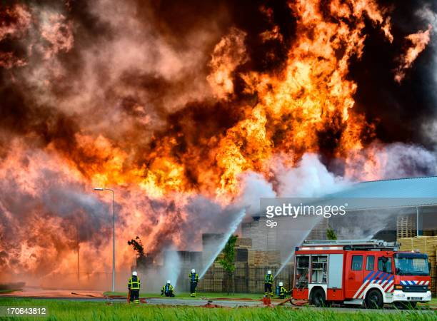 fire fighting in an industrial area - firefighter stock pictures, royalty-free photos & images