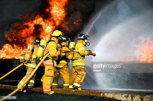 fire fighting - firefighter stock pictures, royalty-free photos & images