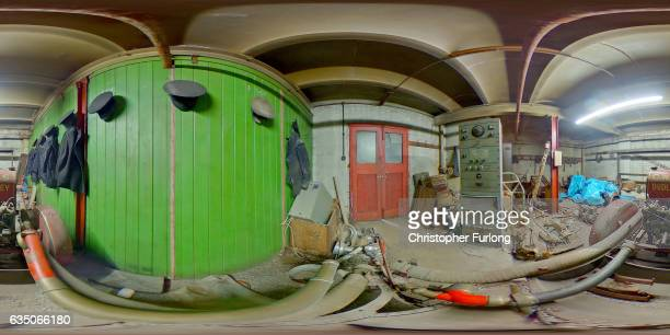 A fire fighting pump and uniforms sit covered in dust in the hidden fire station of a Black Country factory on February 13 2017 in Dudley England A...