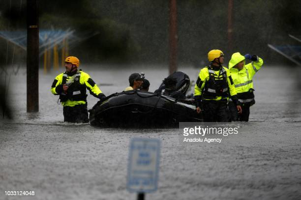 Fire firefighters use a boat to rescue three people from their flooded home during the Hurricane Florence in New Bern, North Carolina, United States...