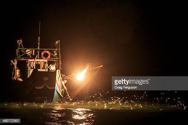 Fire fishing off Taiwan's north coast. The flame is placed to the port side or bow of the boat to attract the fish..