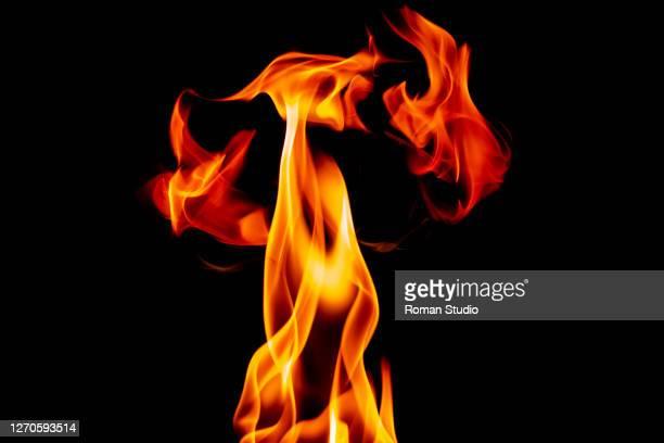 fire flames on black background - feuer stock-fotos und bilder