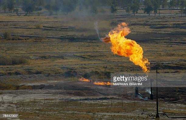 Fire flames rise from a petroleum well at an oil refinery in the oil rich city of Kirkuk north of Baghdad 13 December 2007 A High ranking Iraqi...