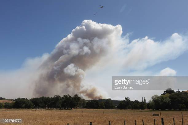 Fire flares up as firefighters battle a blaze as 170 homes have been evacuated from the area in the Tasman district February 7 2019 in Richmond near...