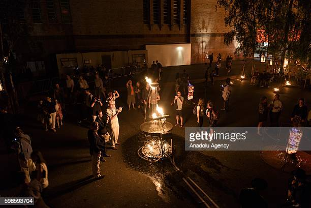 Fire Garden event transforming the front lawn of the Tate Modern into a crackling afterdark adventure made from burning structures cascading candles...