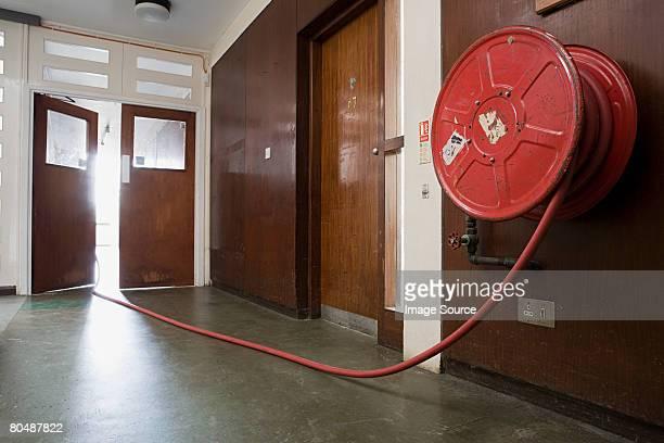 Fire hose in corridor