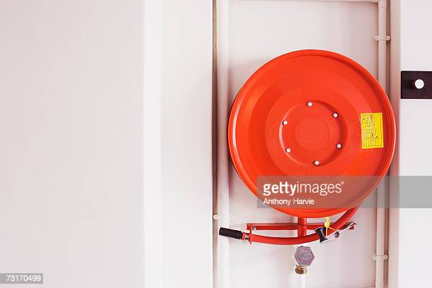 Fire hose in office environment, close-up