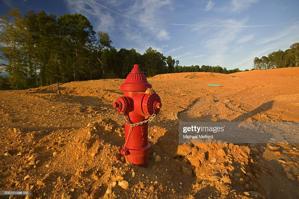 Fire hydrant in soil on construction site : Stock Photo