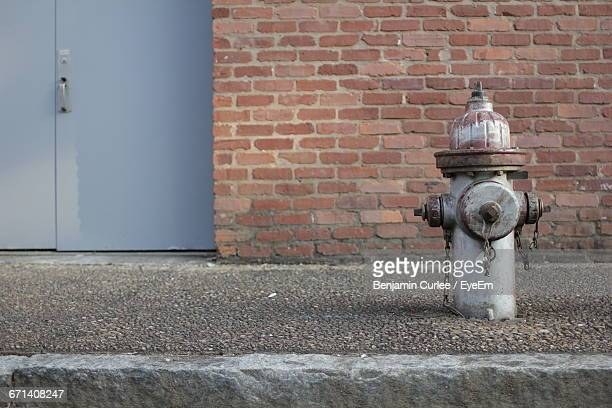 fire hydrant on sidewalk - fire hydrant stock pictures, royalty-free photos & images