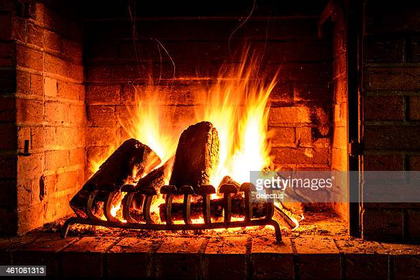 fire in a fireplace - warming up stock pictures, royalty-free photos & images