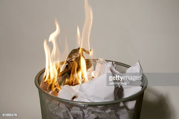 fire in a wastepaper basket - burning stock pictures, royalty-free photos & images