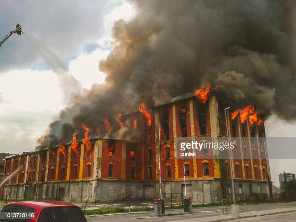 fire in an old building - fire natural phenomenon stock pictures, royalty-free photos & images