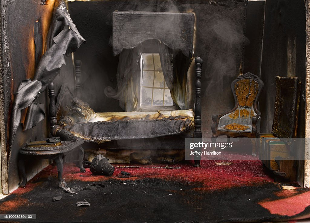 Fire in bedroom of model house, close-up : Stock Photo